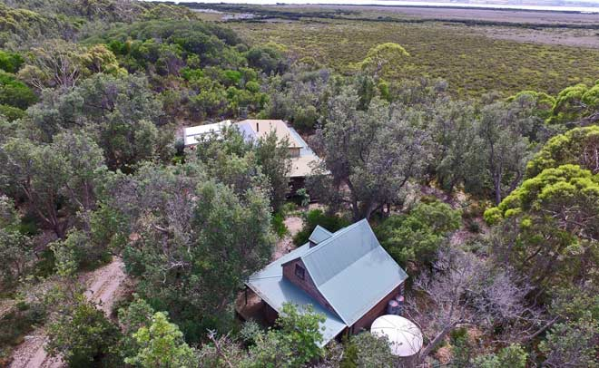 Aerial view of Venus Bay Eco Retreat showing the accommodation cottage in the foreground.
